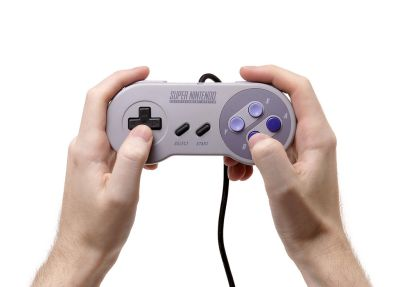 1024px-SNES-Controller-in-Hand